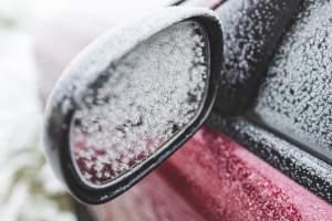 Icy car mirror | Sturgis hail repair